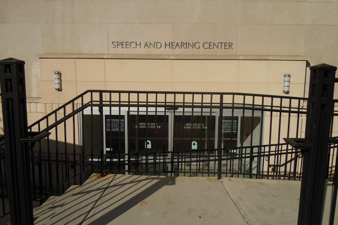 Outside of the Speech and Hearing Center building with its sign.
