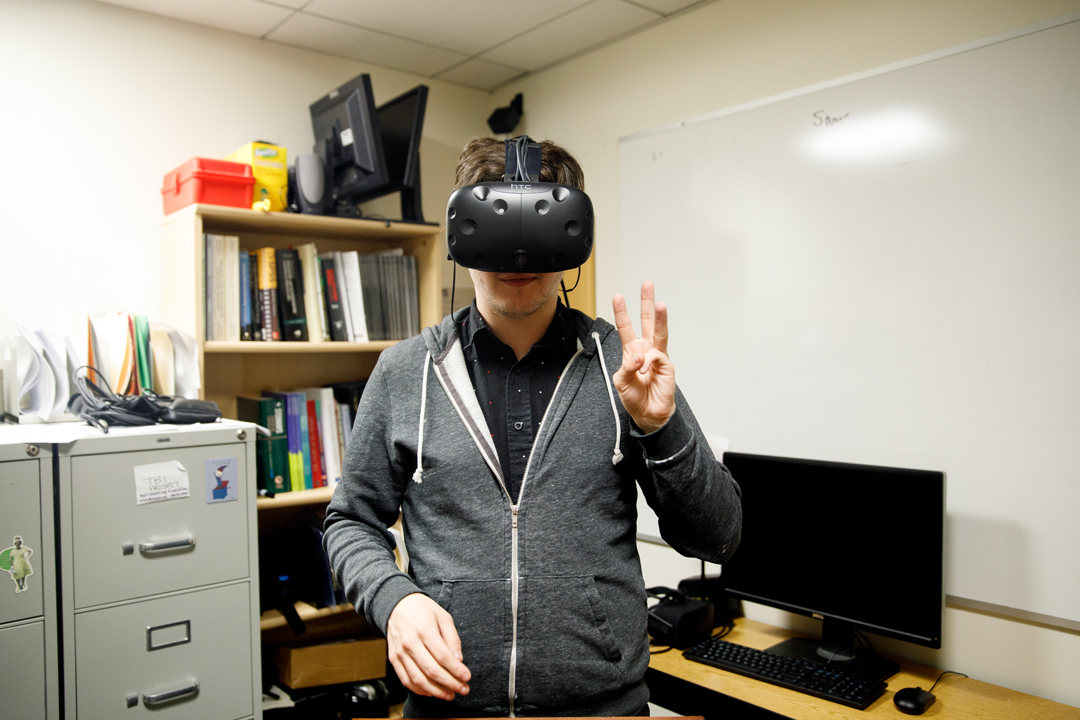 A Speech and Hearing participant wears a virtual reality headset.