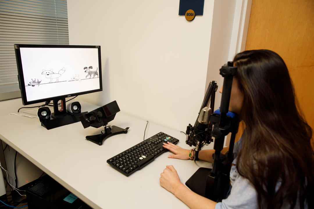 Graduate student Maria Braiuca demonstrates eye-tracking technology that charts which image patients are viewing in response to verbal cues.